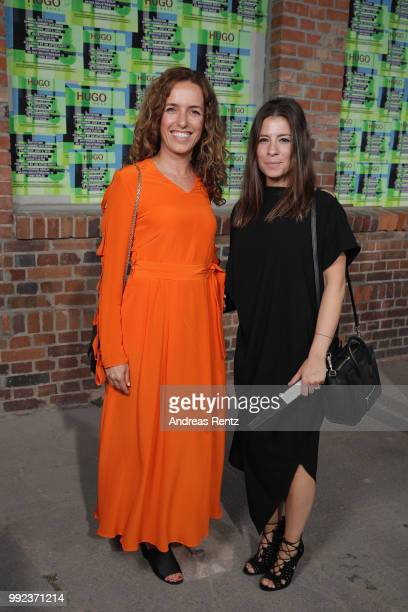 Ulrike Fleischer and guest attend the HUGO show during the Berlin Fashion Week Spring/Summer 2019 at Motorwerk on July 5 2018 in Berlin Germany