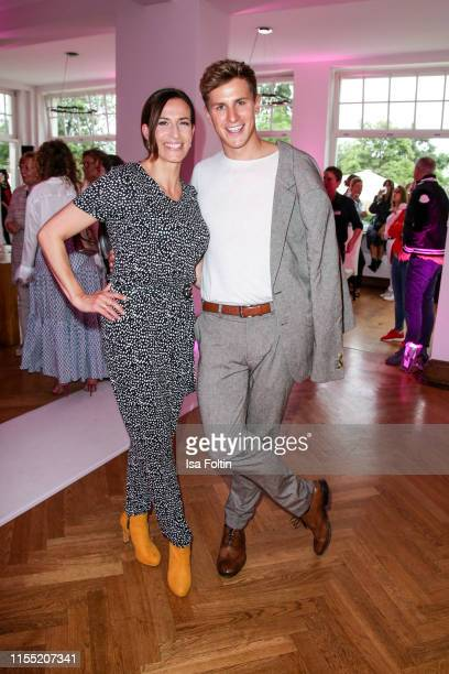 Ulrike Frank and Lukas Sauer during the Ernsting's family Fashion Show 2019 on July 11 2019 in Hamburg Germany