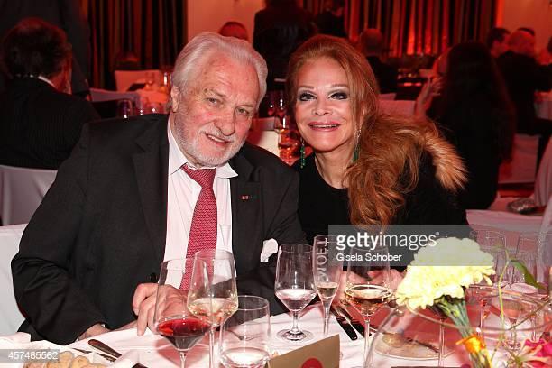 Ulrike Huebner and her husband Erich Kaub attend the Monti Memorial Charity Gala at Hotel Vier Jahreszeiten on October 18, 2014 in Munich, Germany.