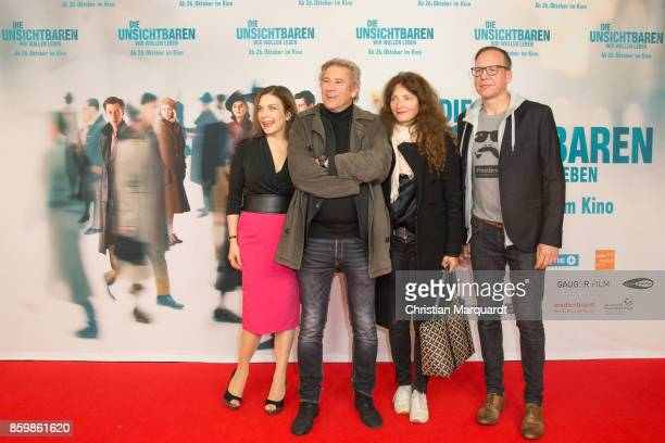Ulrike Lodwig Michael Kind and wife Ursula Andermatt and Stephan Schaefer attend the premiere of 'Die Unsichtbaren' at Kino International on October...