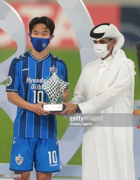 Ulsan Hyundai captain, Ho-Jin Shin , receives the trophy from Sheikh Hamad bin Khalifa bin Ahmed Al Thani, head of the QFA, after the AFC Champions...