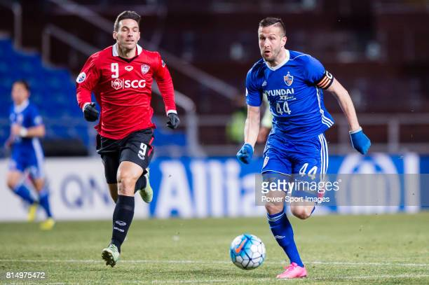 Ulsan Hyundai Forward Ivan Kovacec fights for the ball with Muangthong Forward Xisco Jimenez during the AFC Champions League 2017 Group E match...