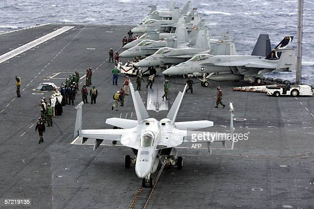 F18 Super Hornets cram the flight deck of the US Navy carrier USS Abraham Lincoln during the Foal Eagle exercises off Ulsan South Korea 30 March 2006...