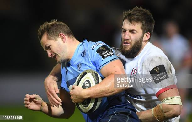 Ulster centre Stuart McCloskey puts in a tackle on Blues wing Hallam Amos during the Guinness PRO14 match between Cardiff Blues and Ulster at Rodney...