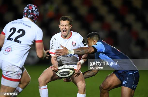 Ulster fly half Billy Burns offloads despite the tackle of Blues player Rey Lee-Lo during the Guinness PRO14 match between Cardiff Blues and Ulster...