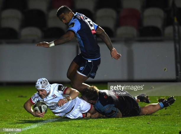 Ulster fullback Michael Lowry dives over to score despite the attempted tackle of Kristian Dacey during the Guinness PRO14 match between Cardiff...