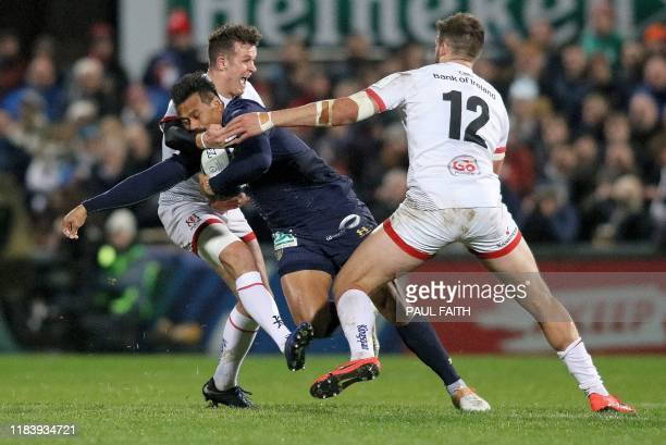 Ulster's Irish centre Stuart McCloskey tackles Clermont's New Zealand centre George Moala during the European Rugby Champions Cup rugby union pool...