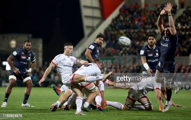 Ulster's Irish scrumhalf John Cooney kicks past Clermont's French lock Paul Jedrasiak during the European Rugby Champions Cup rugby union pool match...