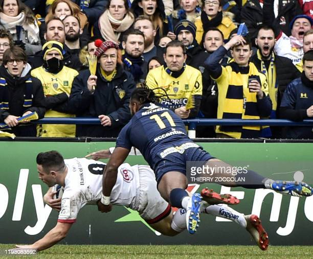 Ulster's scrumhalf John Cooney scores a try during the European Champions Cup rugby union match between Clermont and Ulster at the Michelin stadium...