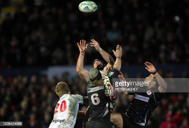 Ulster's Stephen Ferris vies for the ball with Biarritz's Olympique's Magnus Lund and Erik Lund during the European Cup rugby union match at...