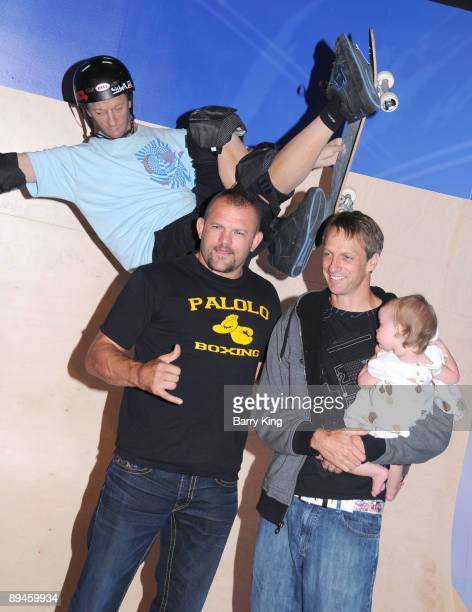 Ultimate Fighting Champion Chuck Liddell former professional skateboarder Tony Hawk and his daughter Kadence Clover Hawk attend the unveiling of...
