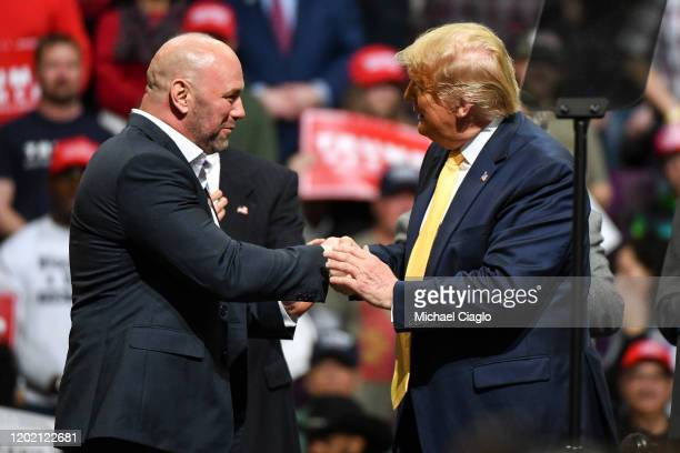 Ultimate Fighting Championship President Dana White greets President Donald Trump on stage during a Keep America Great rally on February 20, 2020 in...