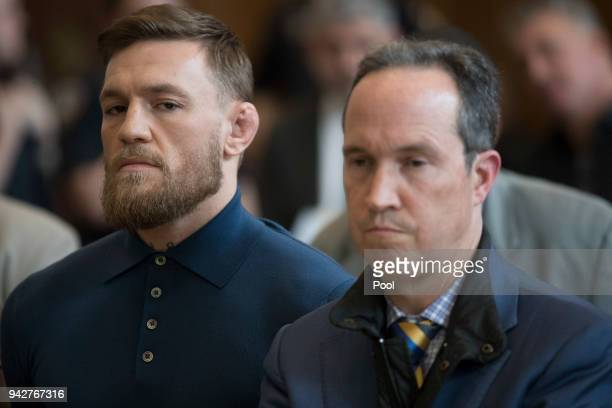Ultimate fighting star Conor McGregor stands with his lawyer Jim Walden during an arraignment in Brooklyn Criminal court on April 6 2018 in New York...