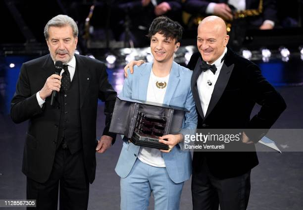 Ultimo with his prize and Claudio Bisio on stage during the closing night of the 69th Sanremo Music Festival at Teatro Ariston on February 09 2019 in...