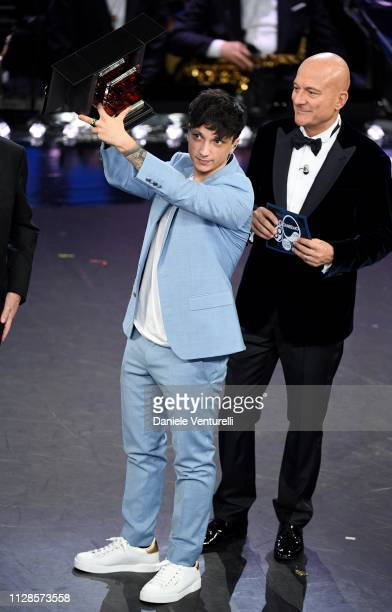 Ultimo with his prize on stage during the closing night of the 69th Sanremo Music Festival at Teatro Ariston on February 09 2019 in Sanremo Italy