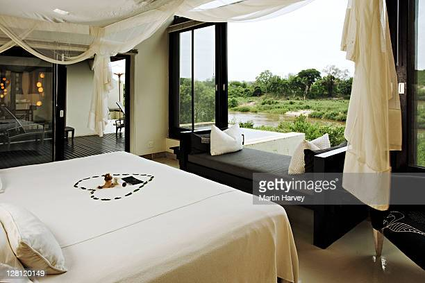 Ultra luxurious bedroom with a wooden deck overlooking the Sabie River. Ivory Lodge, Lion Sands Private Game Reserve, South Africa.