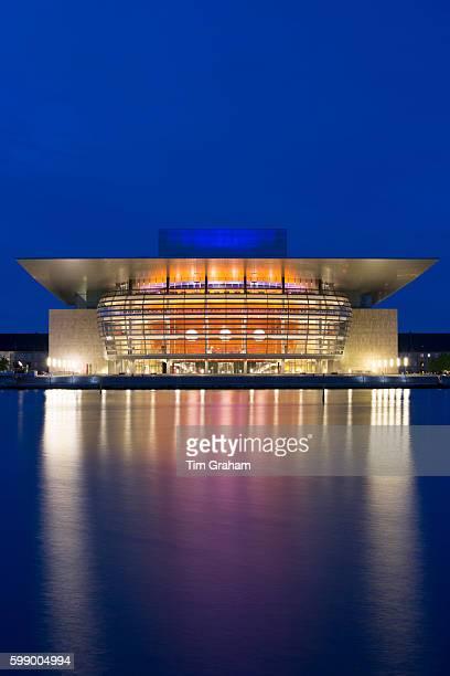 Ultra modern illuminated waterside Opera House by architect Henning Larsen on June 21 2015 in Copenhagen Denmark