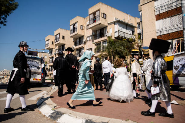 ISR: Purim Festivities Muted As Israel Imposes Curfew Amid Covid-19 Pandemic