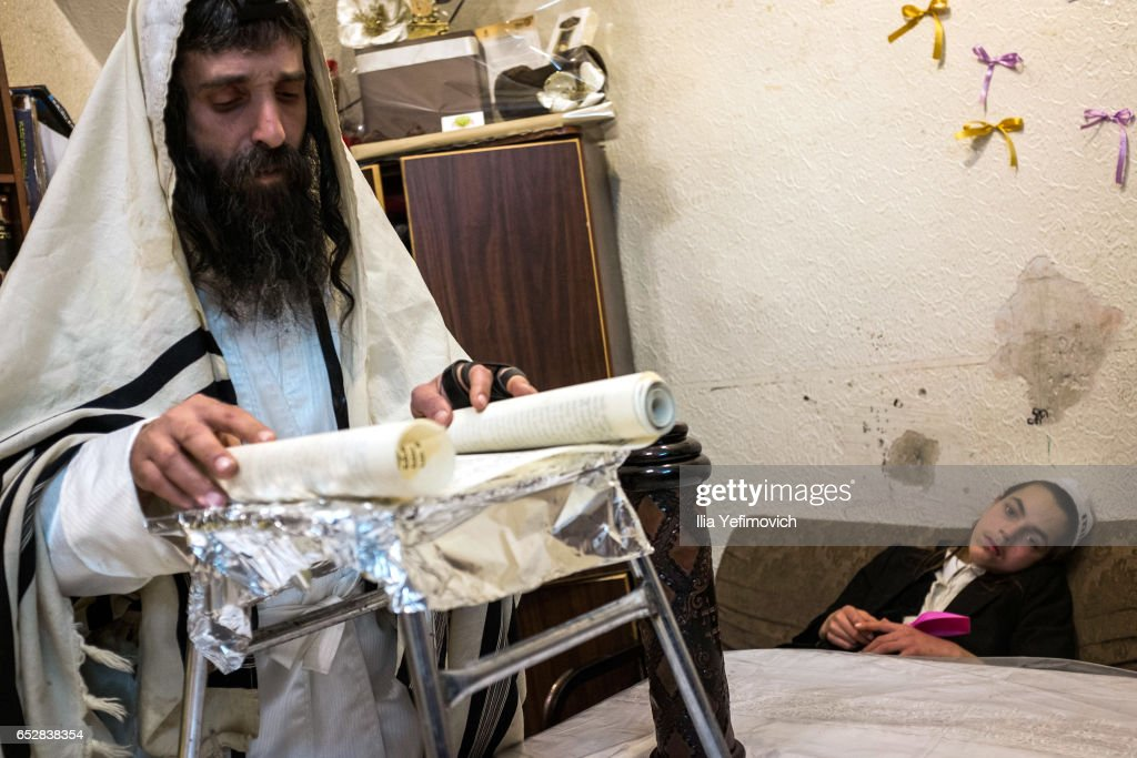 Ultra Orthodox family seen reading the book of Esther on March 13, 2017 in Jerusalem, Israel. The carnival-like Purim holiday is celebrated with parades and costume parties to commemorate the deliverance of the Jewish people from a plot to exterminate them in the ancient Persian empire 2,500 years ago, as described in the Book of Esther.