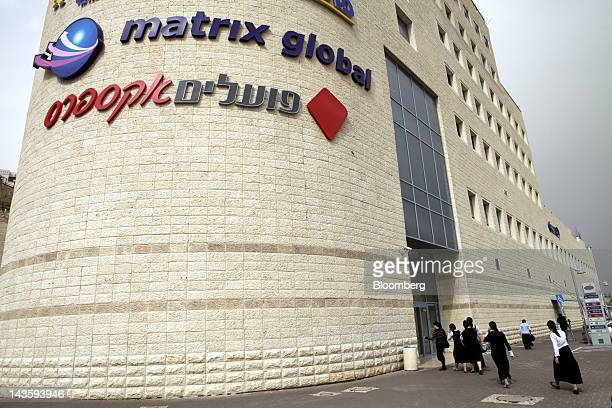 Ultra orthodox Israeli women arrive for work at the offices of Matrix Global a unit of Matrix IT Ltd in Modi'in Illit Israel on Sunday April 29 2012...