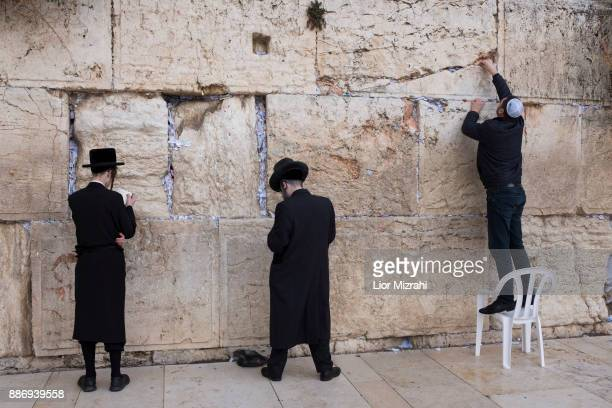 ULtra Orthodox Jewish men prey at the Western Wall in the Old City on December 6 2017 in Jerusalem Israel US President Donald Trump will announce his...