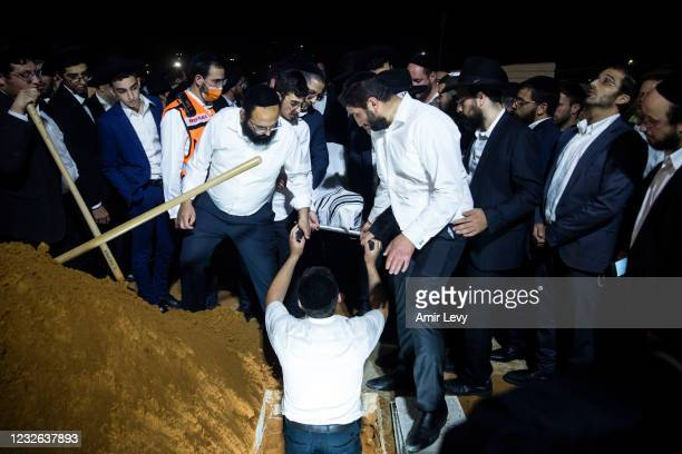 Ultra Orthodox jewish men take part at the funeral of Yedidia Hayut died at a deadly stampede on May 2, 2021 in Petach Tikva, Israel. 45 people died...