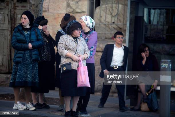 Ultra Orthodox Jewish women watch the scene of an attack at the Jerusalem Central Bus Station on December 10 2017 in Jerusalem Israel An Israeli...
