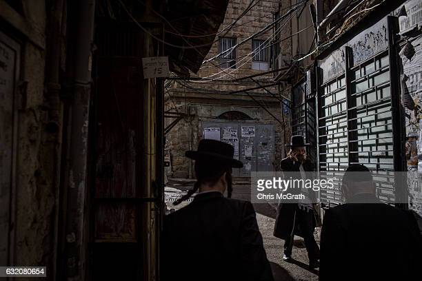 Ultra Orthodox Jews are seen in the street as they prepare for shabbat the Jewish day of rest and seventh day of the week on January 13 2017 in...