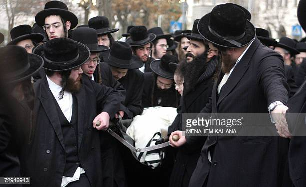 Ultra Orthodox Jews carries the body covered with a Talit or prayer shawl of their Rabbi Arie Leibish Alberstam who died at the age of 96 and who...