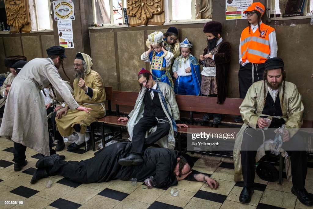 Ultra Orthodox Jews celebrating holiday of Purim on March 13, 2017 in Jerusalem, Israel. The carnival-like Purim holiday is celebrated with parades and costume parties to commemorate the deliverance of the Jewish people from a plot to exterminate them in the ancient Persian empire 2,500 years ago, as described in the Book of Esther.