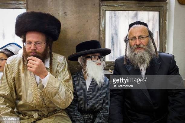 Ultra Orthodox Jews celebrating holiday of Purim on March 13 2017 in Jerusalem Israel The carnivallike Purim holiday is celebrated with parades and...