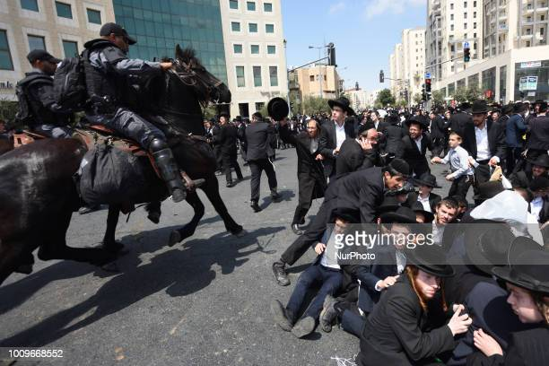 Ultra orthodox Jews clash with police as they protest against the arrest of ultra orthodox men who failed to show for their army draft in Jerusalem...