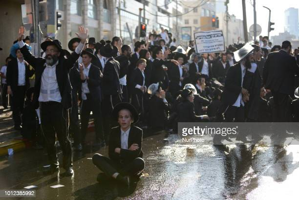 Ultra orthodox Jews clash with police as they protest against the arrest of ultra orthodox men who failed to show for their army draft in BneiBrak...