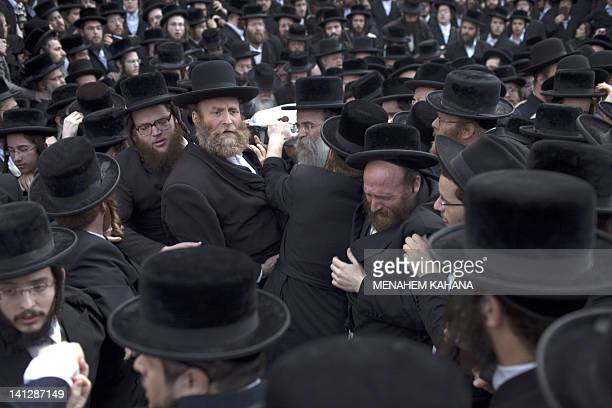 Ultra Orthodox Jews from the Vizhnitz Hasidic dynasty carry their rabbi Moshe Yhoshua Hager's body wrapped in a prayer Shawl before his funeral in...