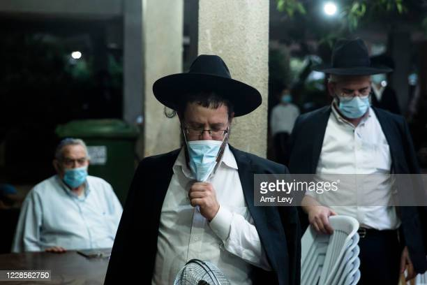 Ultra Orthodox Jews keep social distancing as they pray in an outdoor synagogue amid a Coronavirus pandemic ahead of Rosh Hashanah, the Jewish new...