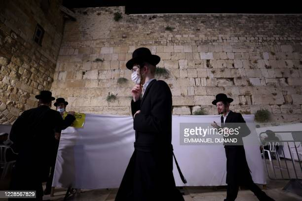 Ultra Orthodox Jews keep social distancing inside dividing cells while participating in the Slichot prayer, the last prayer on the eve of Rosh...