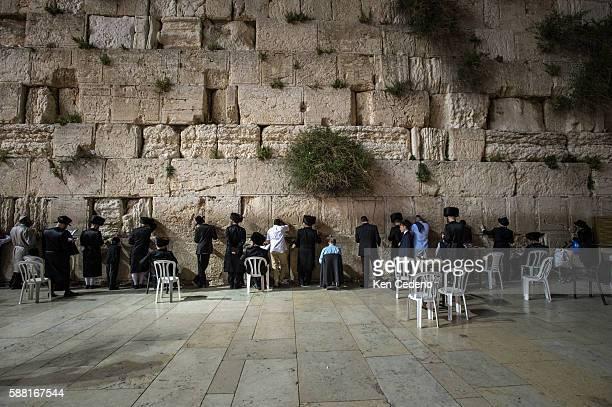 Ultra Orthodox Jews pray during Shabbat at the Western Wall in Jerusalem Israel April 2014 Photo Ken Cedeno