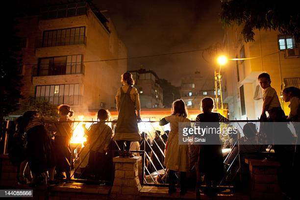 Ultra Ortodox children gather around a bonfire during Lag BaOmer festivities May 09 2012 in Bnei Brak Israel Israelis celebrate the Jewish tradition...