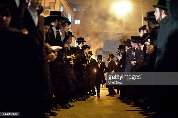 Ultra Ortodox Jews dance around a bonfire during Lag BaOmer festivities May 09 2012 in Bnei Brak Israel Israelis celebrate the Jewish tradition of...