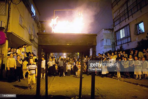 Ultra Ortodox Jews gather around a bonfire during Lag BaOmer festivities May 09 2012 in Bnei Brak Israel Israelis celebrate the Jewish tradition of...