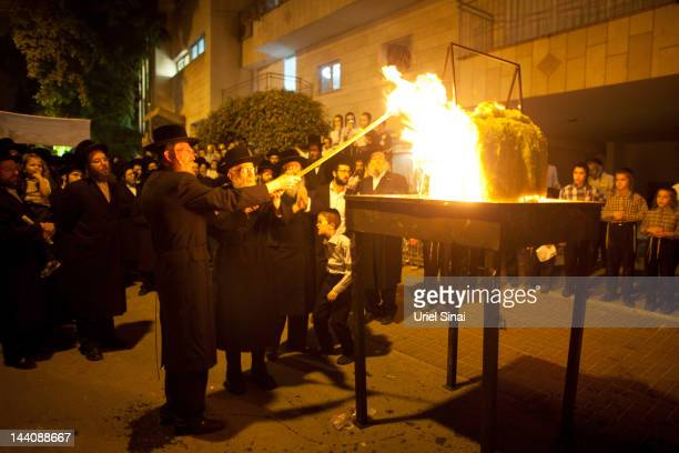 Ultra Ortodox Jews light a bonfire during Lag BaOmer festivities May 09 2012 in Bnei Brak Israel Israelis celebrate the Jewish tradition of Lag...