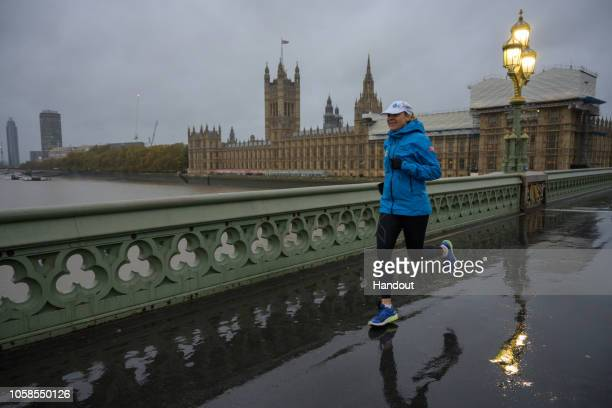 Ultra runner and water campaigner Mina Guli runs across the Thames River during the #RunningDry expedition on November 7 2018 in London England The...