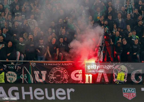 Ultra supporters of Ferencvarosi TC burn a flag of Ujpest FC during the Hungarian OTP Bank Liga match between Ferencvarosi TC and Ujpest FC at...
