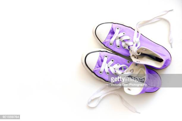 ultra violet shoes over white background. trendy color concept. ultra violet color. color of the year 2018. - purple shoe stock pictures, royalty-free photos & images