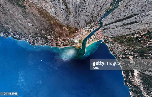 ultra wide angle aerial view of omis and cetina river, dalmatian coast, croatia. - coastline stock pictures, royalty-free photos & images