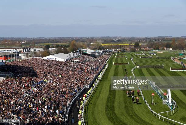 Ultragold ridden by Harry Cobden on his way to victory during the Randox Health Topham Handicap Chase on Ladies Day at Aintree Racecourse on April 7,...