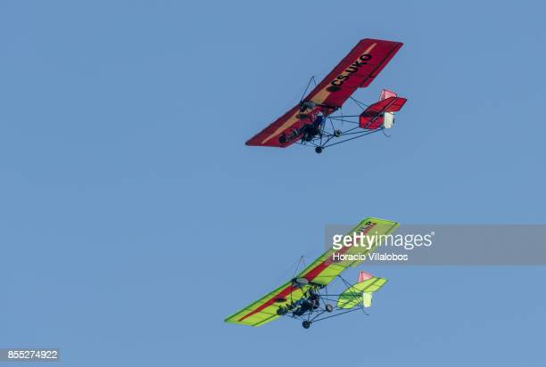 Ultralight airplanes fly over Belem Tower during the commemoration of the 100th anniversary of Portuguese Naval Aviation on September 28 2017 in...