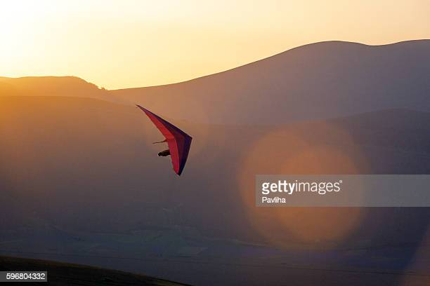 Ultralight -Hang Glider Pilot Launching,lens flare,Castelluccio,Apennines,Italy