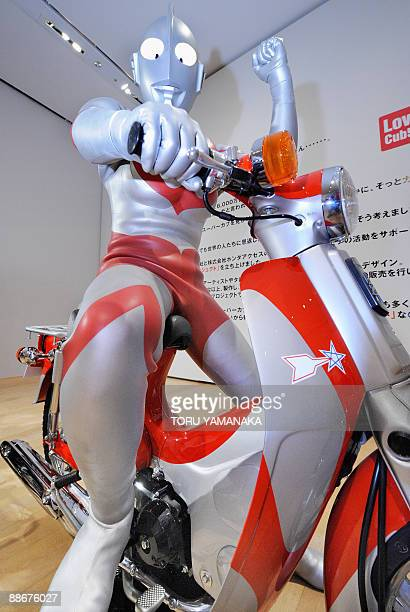"""Ultraman poses on a Super Cub specially designed by Tsuburaya Production during a press preview of """"the Love Cub 50 Project Exhibition"""" to..."""
