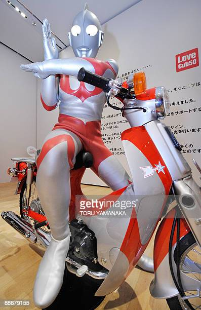 Ultraman poses on a Super Cub specially designed by Tsuburaya Production during a press preview of 'the Love Cub 50 Project Exhibition' to...